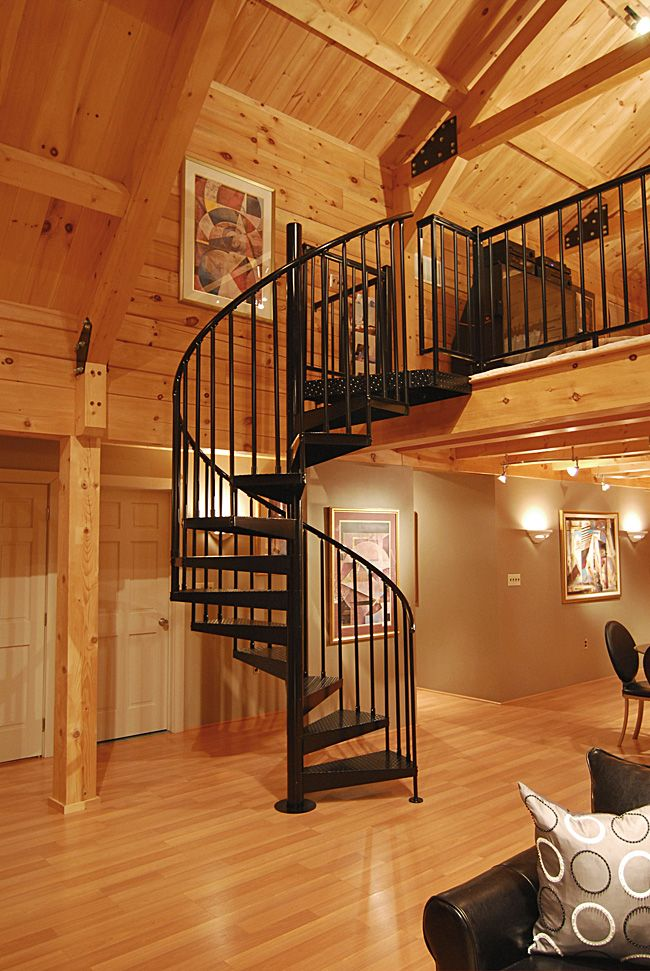 A round aluminum handrail adds character to this classic 5' diameter staircase, which is powder coated black.