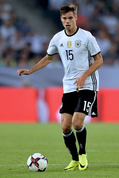 Julian Weigl Photos Photos - Julian Weigl of Germany runs with the ball during the international friendly match between Germany and Finland at Borussia-Park on August 31, 2016 in Moenchengladbach, Germany. - Germany v Finland - International Friendly