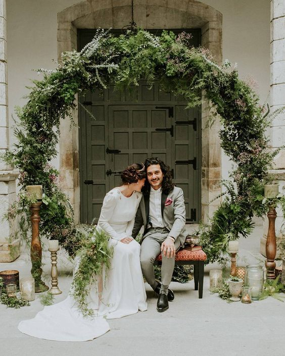 11 More Giant Wedding Wreaths: The Hottest Wedding Trend: #10. An oversized greenery wreath can serve as a backdrop for the ceremony and your portraits