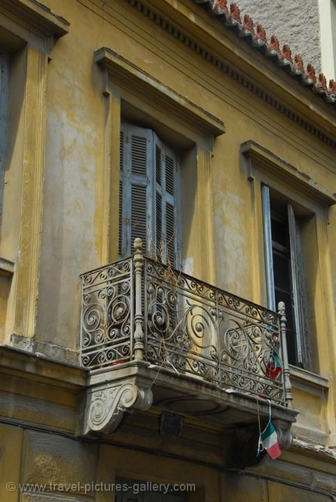 old balcony, Plaka What a beautiful example of neoclassic architecture. Thank goodness there are still a few left standing in Athens.