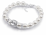 This Alpha Gamma Delta bracelet made with high quality sterling silver and Swarovski pearls, with Clear Swarovski Crystal Rondells for accent. Officially licensed college jewelry made in the USA.