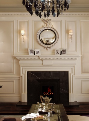 Fireplace Mantle And Federal Mirror With Sconce Lighting