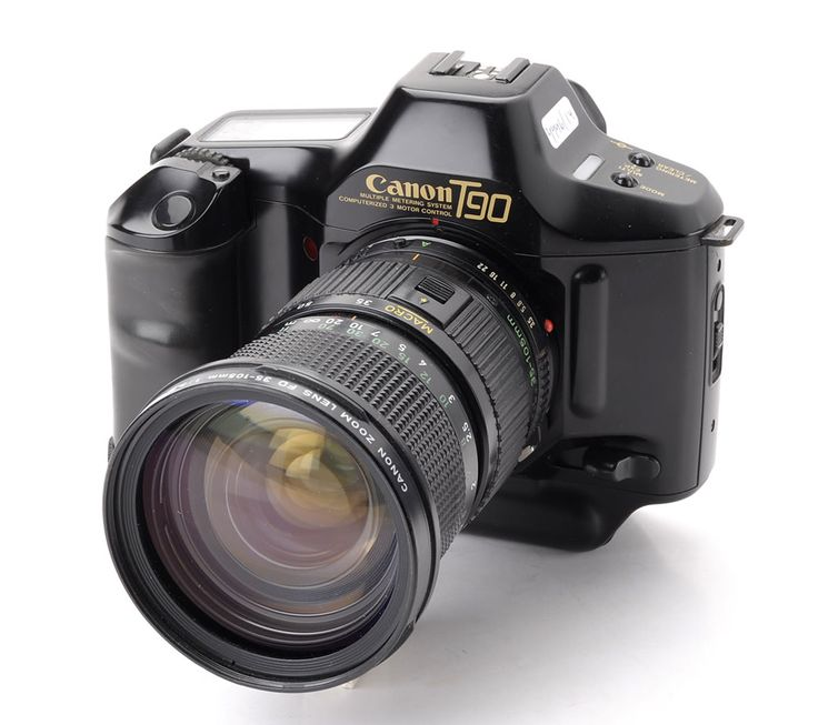 The Canon T90 was my first real camera, and a what a camera it was! Its design (by Luigi Colani) is the basis for Canon's digital SLRs of today. I do wish I hadn't sold it.