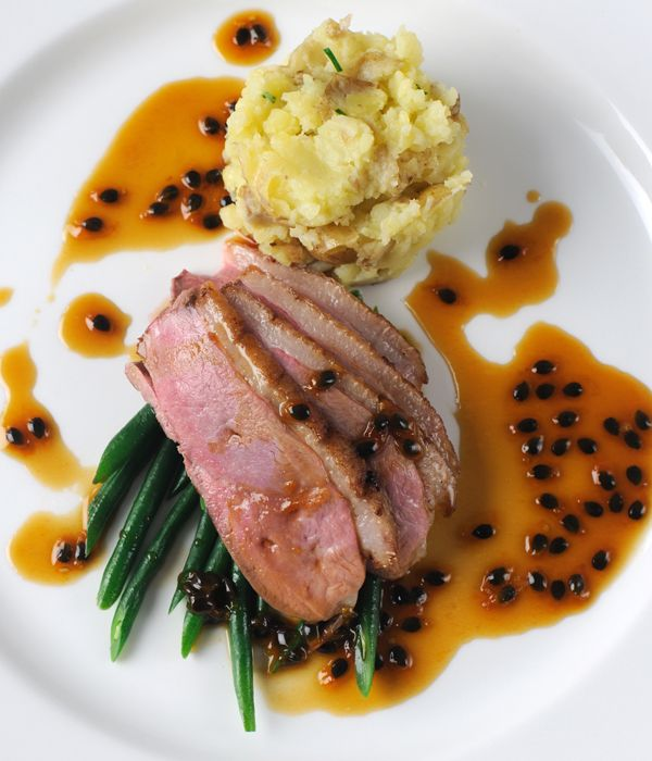 Beautifully cooked duck breast is paired with a remarkable passion fruit sauce in this duck recipe from Marcello Tully.