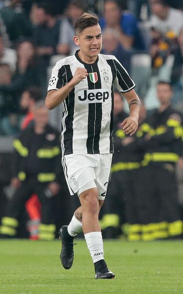 Paulo Dybala of Juventus FC celebrates after scoring the opening goal during the UEFA Champions League Quarter Final first leg match between Juventus and FC Barcelona at Juventus Stadium on April 11, 2017 in Turin, Italy.