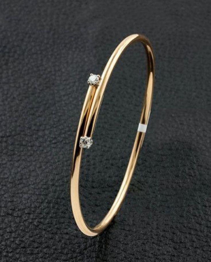 Gold bangle with 2 stone diamond