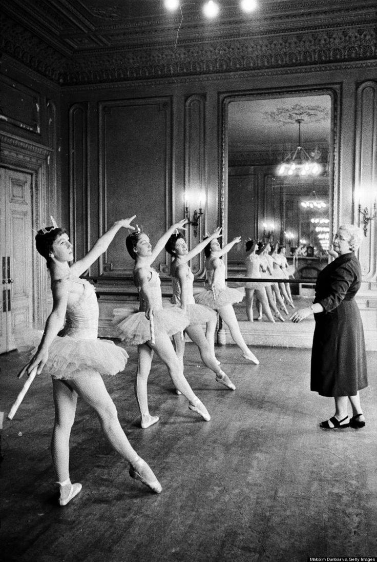 Ballet teacher Marjorie Middleton instructing her pupils in ballet positions during a lesson in one of the studios at the Scottish Ballet School at Grosvenor Crescent, Edinburgh in 1955.