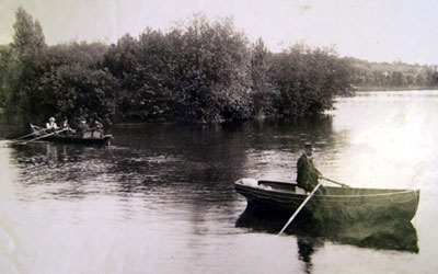 A photograph showing rowing boats on Roath Park Lake.
