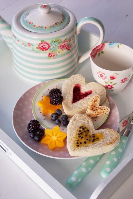 tea with fruit and finger sandwiches