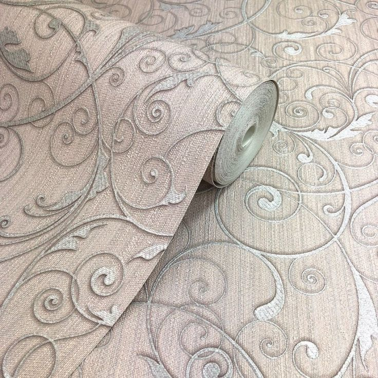 Belgravia Rossini rose gold leaf scroll wallpaper 4740. Belgravia Rossini, a luxury heavy weight Italian vinyl wallpaper with an elegant metallic silver leaf scroll design layered on a rose gold woven thread effect background with gold highlights.