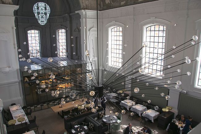 .PSLAB's chandelier at The Jane restaurant, housed in a former chapel for a military hospital in Antwerp, Belgium. Photo courtesy of .PSLAB.