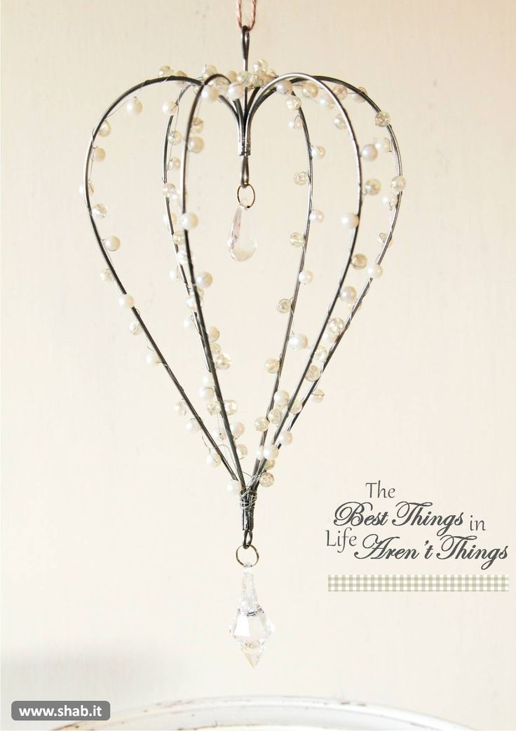 Pretty Heart Hanging Decoration- Pretty sure you could use coat hangers, craft wire, pearl beads and fishing line to make this.