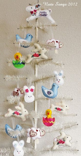 Feather tree with adorable handmade felt ornaments