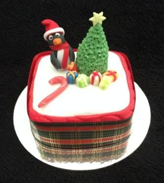 Penguin and tree Christmas Cake by Chaos Cakes za