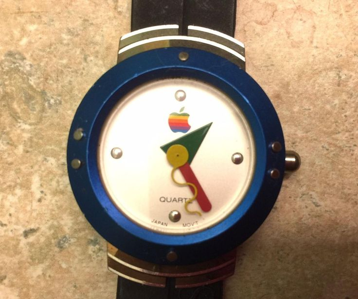 $130 2016 Rare vintage Apple Computer Watch with Mac OS embedded on band. Stylish eye catching design with 3 moving hands. Blue metal watch face outline and clasp. Recently added photos of back which still has