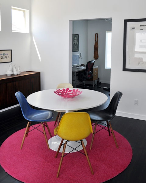 tulip table and multi colored chairs
