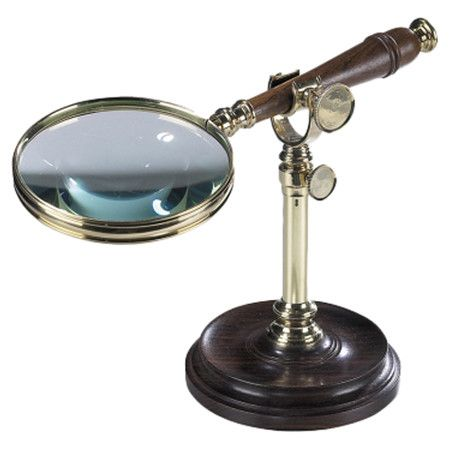 Classic magnifying glass on an adjustable stand.     Product: Magnifying glass   Construction Material: Metal, wood an...