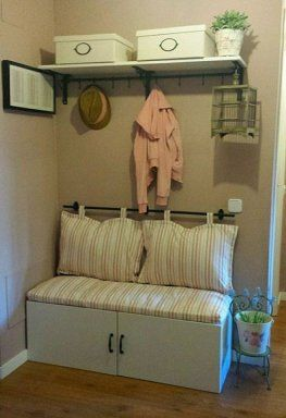 Good idea with the rod for the pillows. Cute entryway.