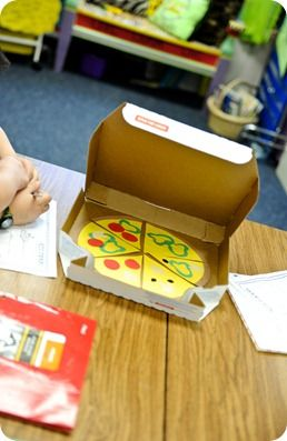 from the Fab Cara Carroll... 4 pizza boxes with different pizza slices to teach first graders about fractions