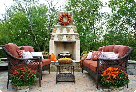 awesome stone outdoor fireplace and patio ready for Fall.