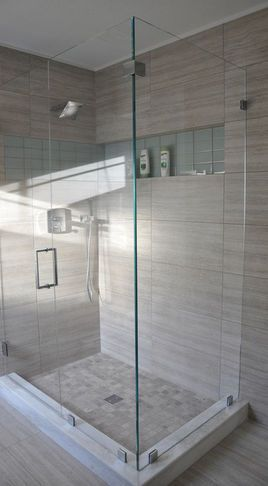 Contemporary looking tiles, and the raised perimeter of this #wetroom give this…