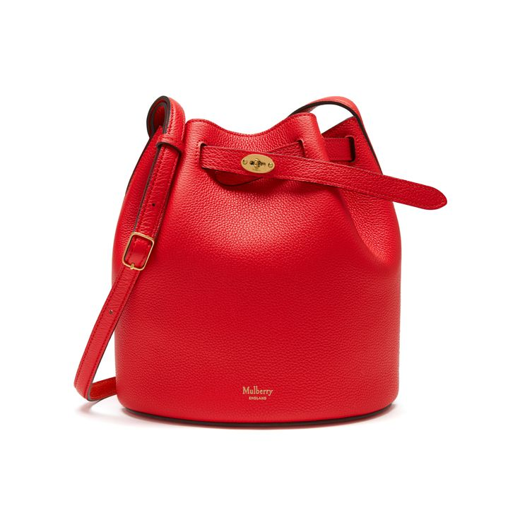 Shop the Abbey in Fiery Red & Bright Orange Small Classic Grain Leather at Mulberry.com. The Abbey is a traditional 'bucket bag' with drawstring detailing, contrast lining and a range of eye-catching or iconic leather finishes. The Abbey features the iconic postman's lock as a nod to Mulberry's heritage DNA, securing a simple belt closure on a timeless, easy to wear style.