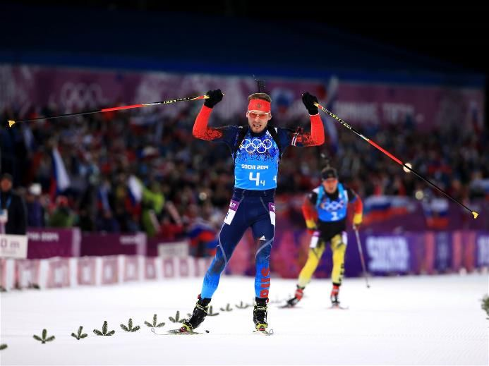 Anton Shipulin of Russia celebrates winning the gold medal during the Men's 4 x 7.5 km Relay during day 16 of the Sochi 2014 Winter Olympics at Laura Cross-country Ski & Biathlon