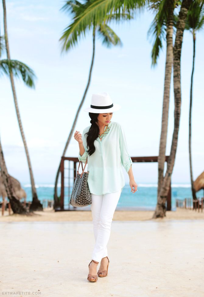 vacation / summer outfit: white jeans + pastel tunic top, goyard tote, panama hat