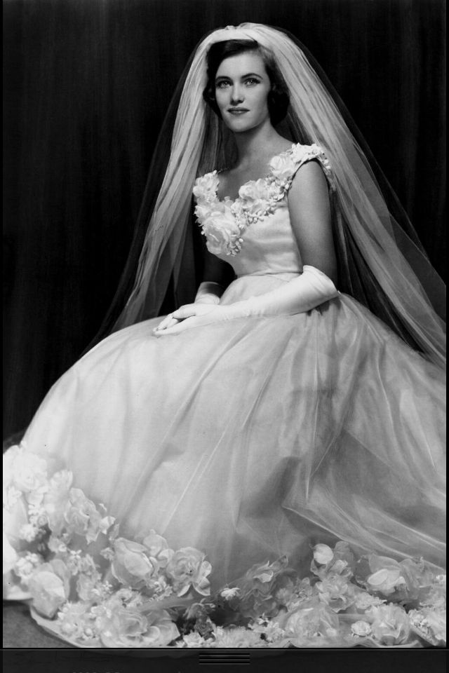 1960s bride wearing an amazing wedding dress.