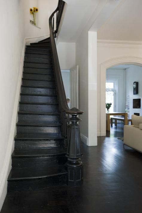 Elizabeth Roberts in Brooklyn. Roberts dyed the original battered floors using a mix of half dark mocha and half black and painted the #stairs and balusters in high-gloss #floor paint.