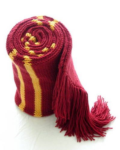 """harry potter gryffindor scarf - Craft info: Pattern: atypically.knit pattern [I found the correct link!! ~ http://web.archive.org/web/20080113034230/knit.atypically.net/scarves/hogwarts/pattern.shtml], with modifications: larger needles (size 10), co 72 stitches, made fringe about 6"""" long (same as length of large MC stripe).  Needles: size 10 bamboo 16"""" circular.  Yarn: Utopia worsted-weight acrylic, Pomegranate (MC) and Maize (CC).  Dimensions: About 8.5 feet long, 8 inches wide"""