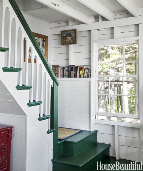 This homeowner painted the staircase banister and treads in Benjamin Moore's Chrome Green.