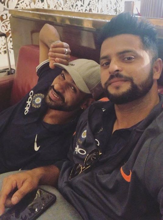 Suresh Raina clicks a picture with Shikhar Dhawan while waiting for a flight to Colombo - facebook.com/MyCricketTrolls