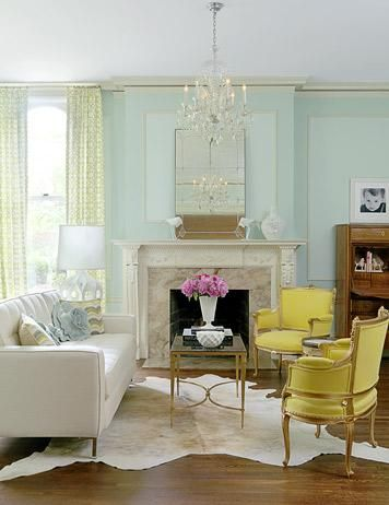 Like the cool mint green mixed with those fab yellow and gold chairs. And a white fur rug gives great texture- want to curl up on it.
