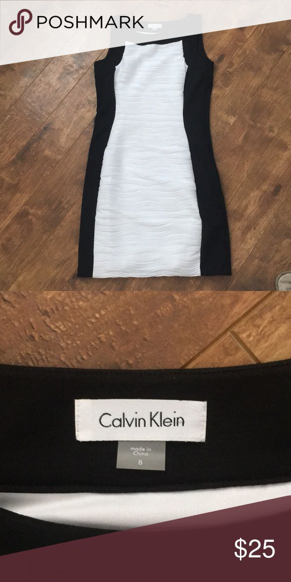 Black and white cocktail dress Black and white dress. It doesn't have tags but I have never worn it. Calvin Klein Dresses