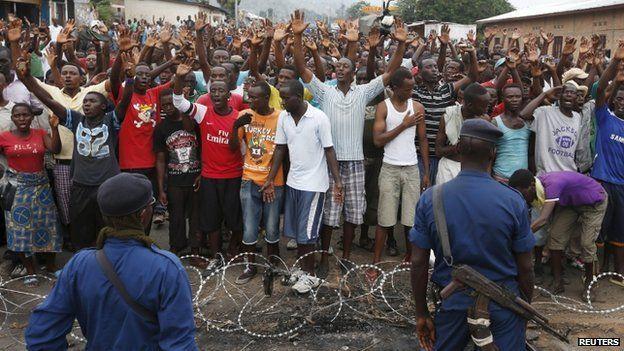Policemen stand in front of demonstrators during a protest against Burundi President Pierre Nkurunziza and his bid for a third term in Bujumbura, Burundi, May 20