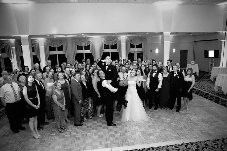 Photo by Curtis Knight. As a DJ, Curtis Knight tries to get the best man to lift up the groom during the group photo which he considers a necessary part of your wedding celebration! (When this photo was taken, Curtis had microphone in one hand and Canon 1DX in the other hand)