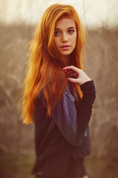 I love red heads! Great hand position in the hair as well. People never know what to do with their hands in pictures and this is a good example. Just play with your hair a little, it's delicate and feminine.