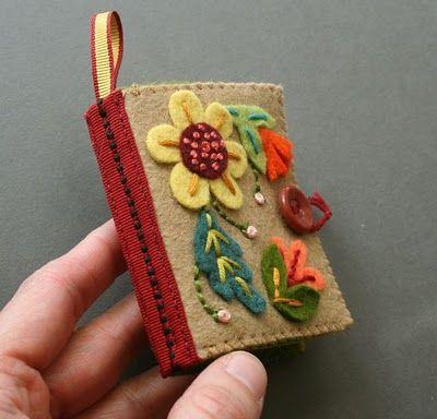 The cutest little needlebook ever:  tutorial http://mmmcrafts.blogspot.com/2011/02/needle-book.html