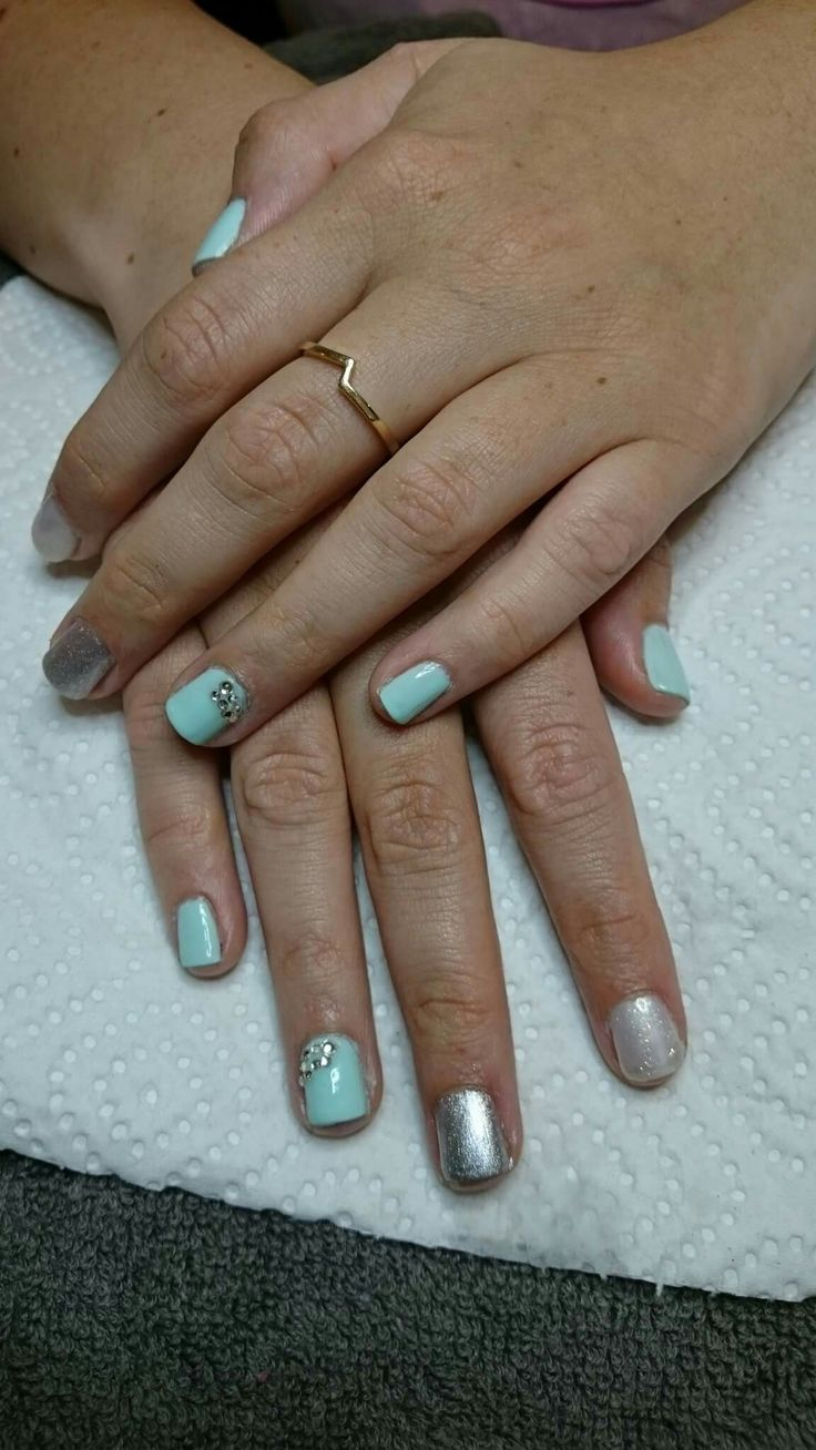 Gel polish overlay. Mint green and gold glitter
