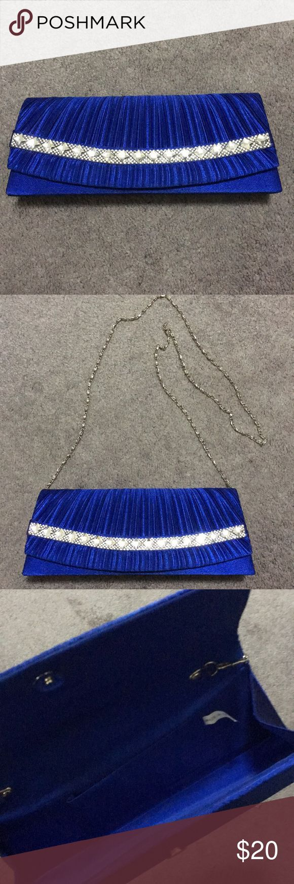 Royal Blue clutch bag This is a beautiful royal blue clutch bag with a shiny silver gem design across the front. Hold it in your hand or wear it on your shoulder. Add a little bling to your outfit! Bags Clutches & Wristlets