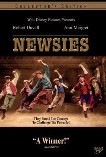 """A musical based on the New York City newsboy strike of 1899. When young newspaper sellers are exploited beyond reason by their bosses they set out to enact change and are meet by the ruthlessness of big business.""  One of my best *happy* song is ""Seize the Day"" from Newsies."