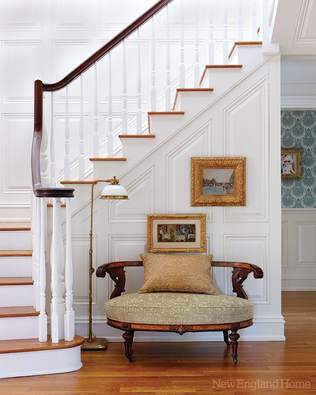 The reupholstered settee in a New Canaan entryway is a treasured family heirloom. Photo by Michael Partenio