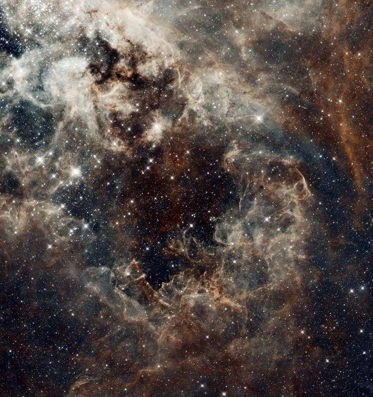 Tarantula Nebula in the Large Magellanic Cloud -  Credit: NASA, ESA, ESO, D. Lennon (ESA/STScI), and the Hubble Heritage Team (STScI/AURA)
