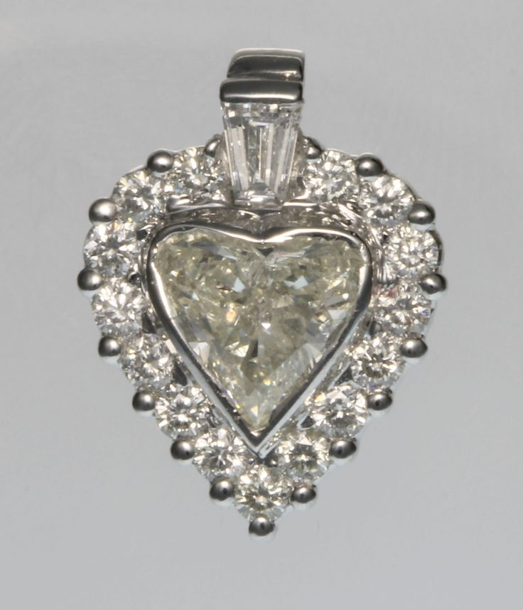 Lot 769, An 18ct white gold heart shaped diamond pendant, the centre stone approx. 1.81ct, surrounded by brilliants approx. 0.6ct, together with an IGL certificate, est £2000-2500