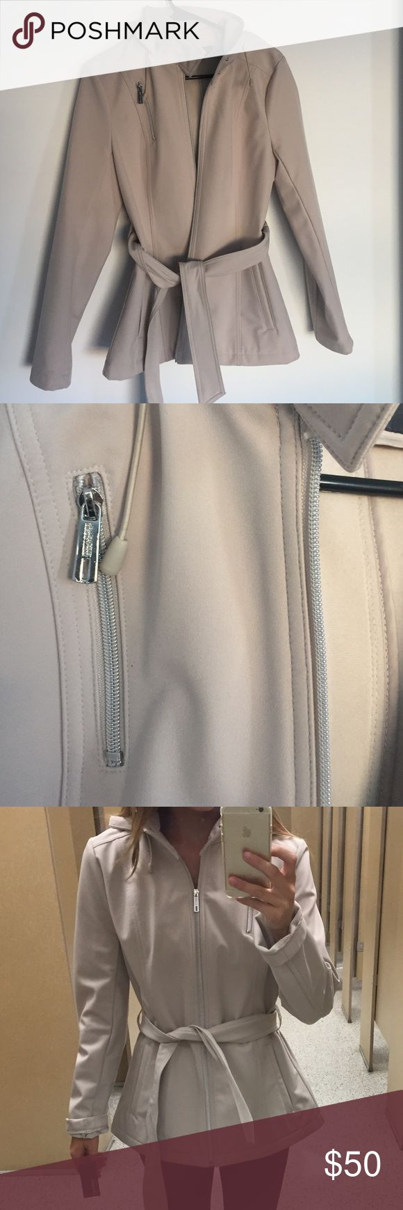 Kenneth Cole Waterproof Jacket Kenneth Cole zip up jacket with belt. Interior is soft and warm, exterior is water resistant. Perfect for rainy days in spring and fall. Color is like a gray/taupe mixture. In great condition. Using brand for exposure only. Zara Jackets & Coats Utility Jackets