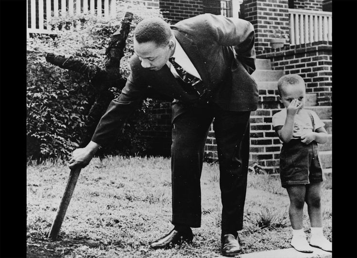 In this first photo from 1960, Dr. Martin Luther King Jr. pulls up a cross that was burned on lawn of his home in Atlanta, as his son stands next to him. Today, in the United States, we observe Martin Luther King Jr. Day, a federal holiday established in 1986 to honor the slain civil rights leader and his accomplishments. In the 1950s and 60s, King grew into a powerful speaker and promoter of nonviolent resistance to unjust laws, inspiring thousands to protest the injustices of segregation…