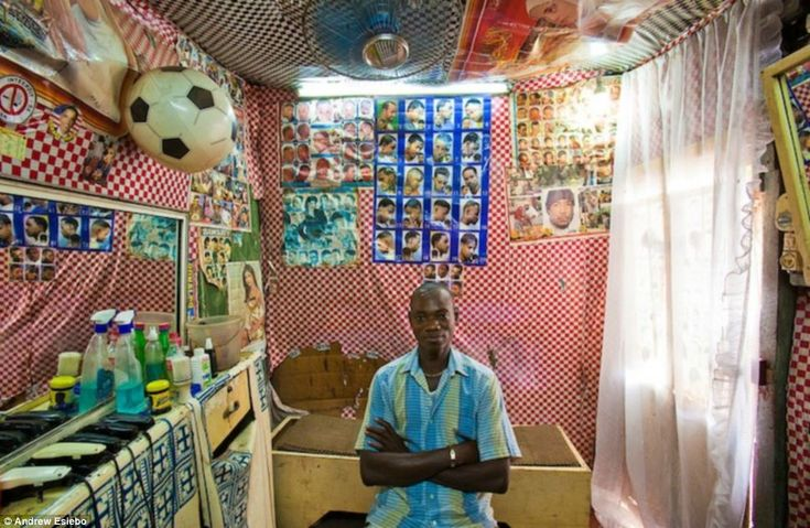 Different styles: Once again football is an influence on the decor in Mali, but this barbershop features something akin to a menu of possible haircuts