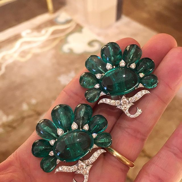 BHAGAT! A Pair of Emerald and Diamond Ear Clips, set with one cabochon Colombian emerald weighing 14.48 carats and one cabochon Colombian emerald weighing 10.55 carats, surrounded by 14 Colombian emerald beads weighing 64.95 carats #FDGallery_SOLD