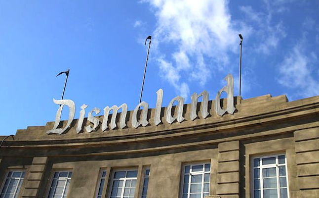 Dismaland aims to help house hundreds of refugees.Dismaland Sign.Credit@FlickrUserKathrynYengel